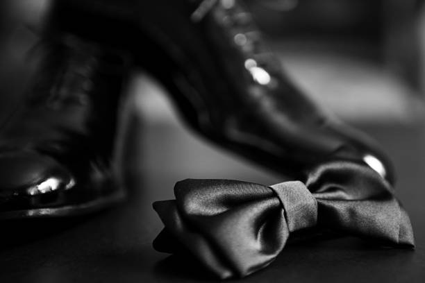 Black bow tie and black shiny shoes Tied Bow, Black Shoes,  Bow Tie, Black Color evening wear stock pictures, royalty-free photos & images
