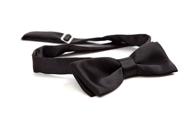 Black bow tie on white A black bow tie on a white background with copy space bow tie stock pictures, royalty-free photos & images