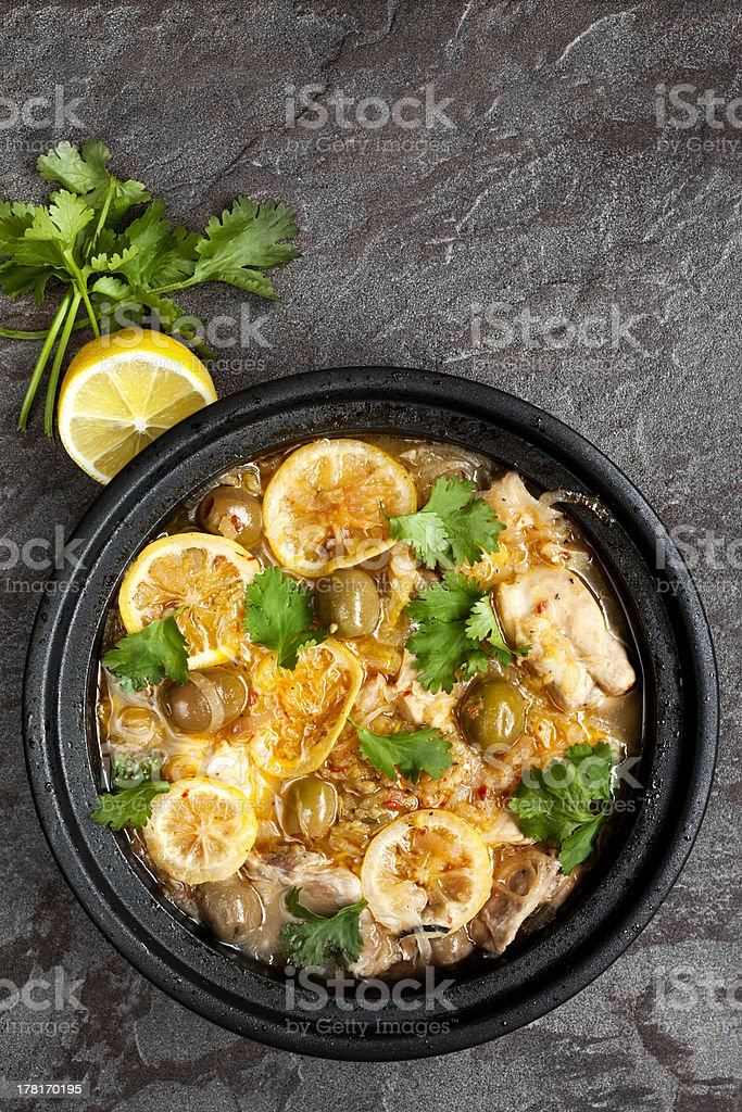 A black bowl of chicken Tagine stock photo