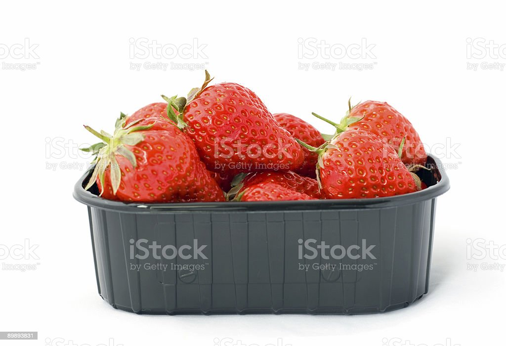 Black box filled with strawberries royalty-free stock photo