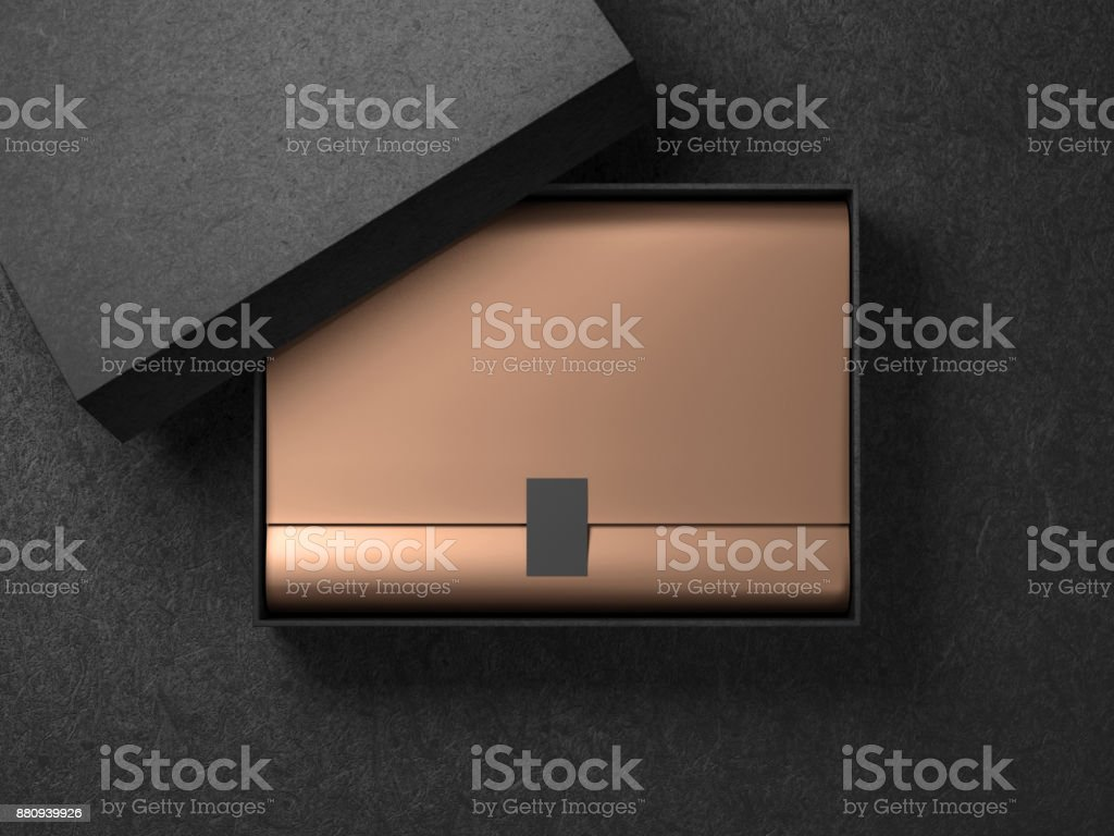 Black Box with Golden wrapping paper and label sticker. Horizontal stock photo