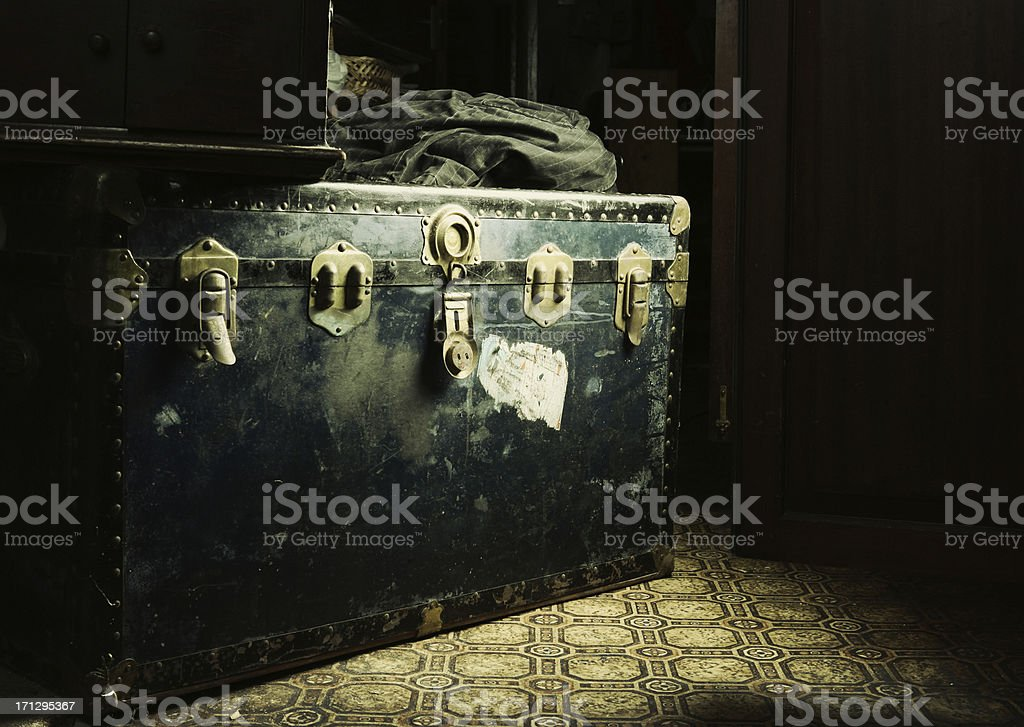 A black box with locks in a dimly lit room stock photo