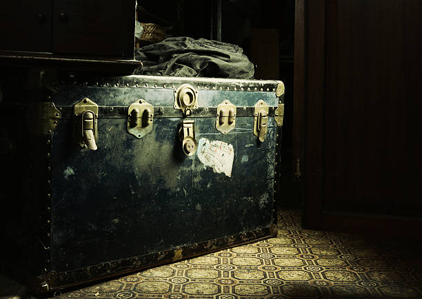 a black box with locks in a dimly lit room - dimly stock pictures, royalty-free photos & images