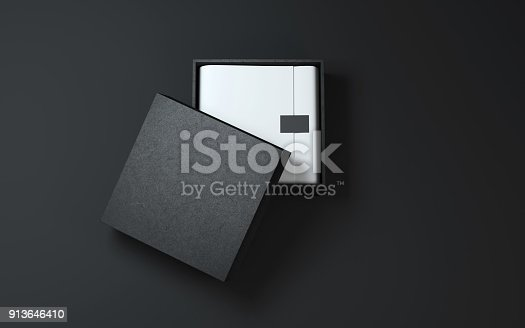 istock Black Box with wrapping paper and label or tag 913646410