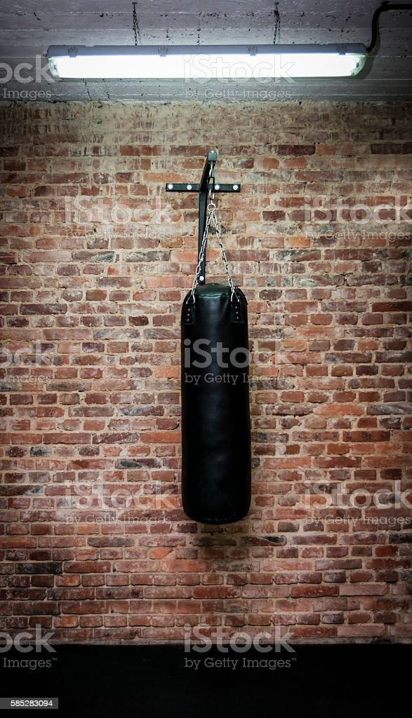 Black Boxing Bag In Training Room Stock Photo - Download
