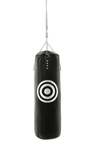 black boxing bag with target bullseye stock photo