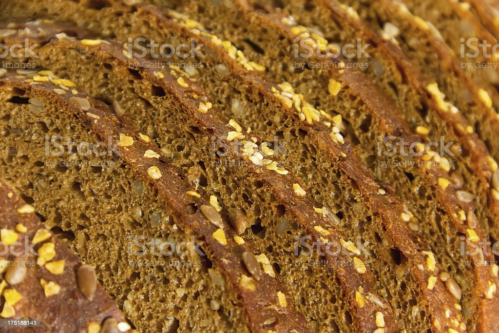 Black bread with seeds of sesame, corn and flax royalty-free stock photo