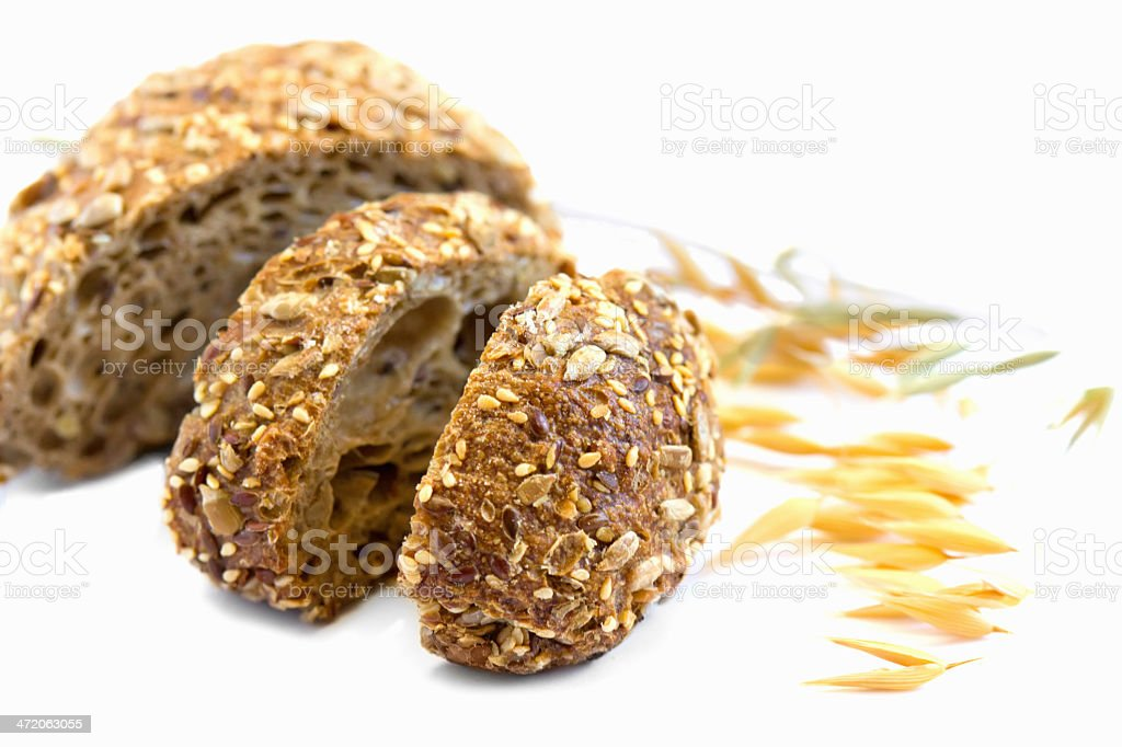 Black bread with seeds of sesame, corn and flax stock photo