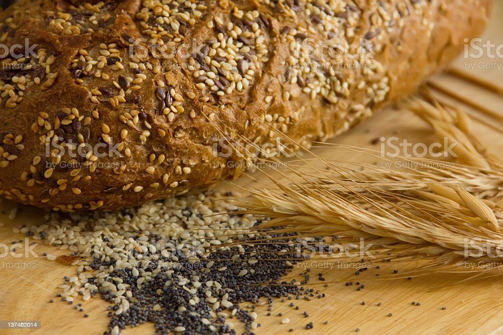 Black bread with seeds of sesame, poppy and flax royalty-free stock photo