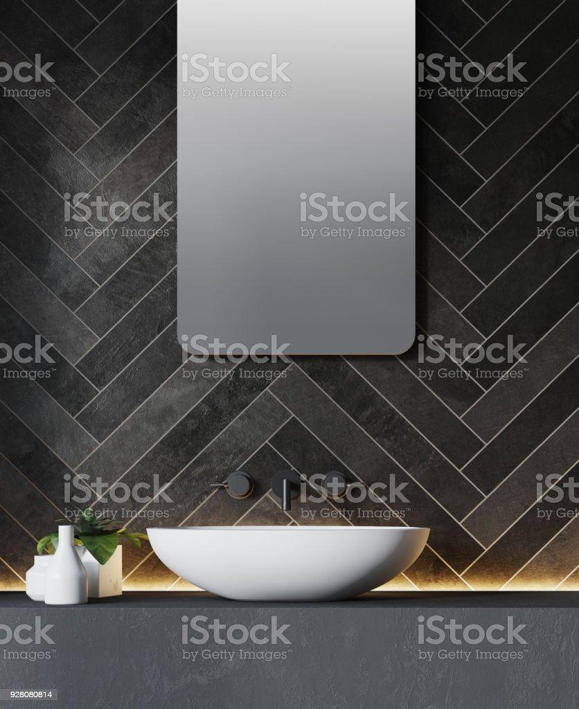 Black brick wall and bathroom sink stock photo