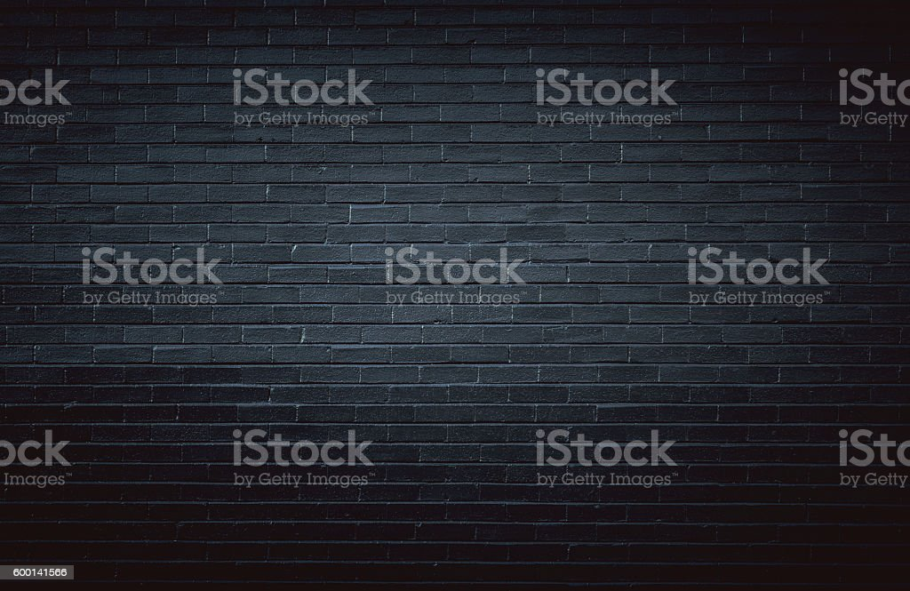 Black brick wall background stock photo