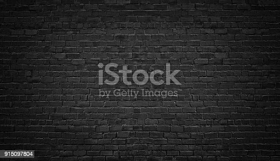 istock black brick wall background. texture dark masonry 915097804