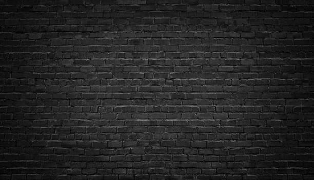 black brick wall background. texture dark masonry - foto stock