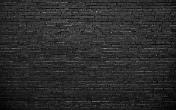 black brick wall, brickwork background for design - foto stock