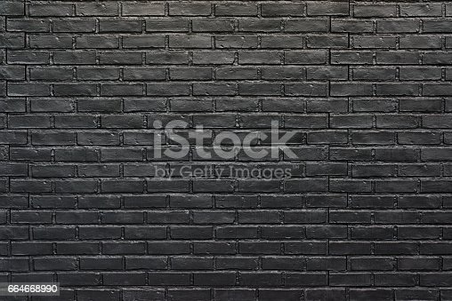 istock Black brick wall for background. Painted bricks 664668990