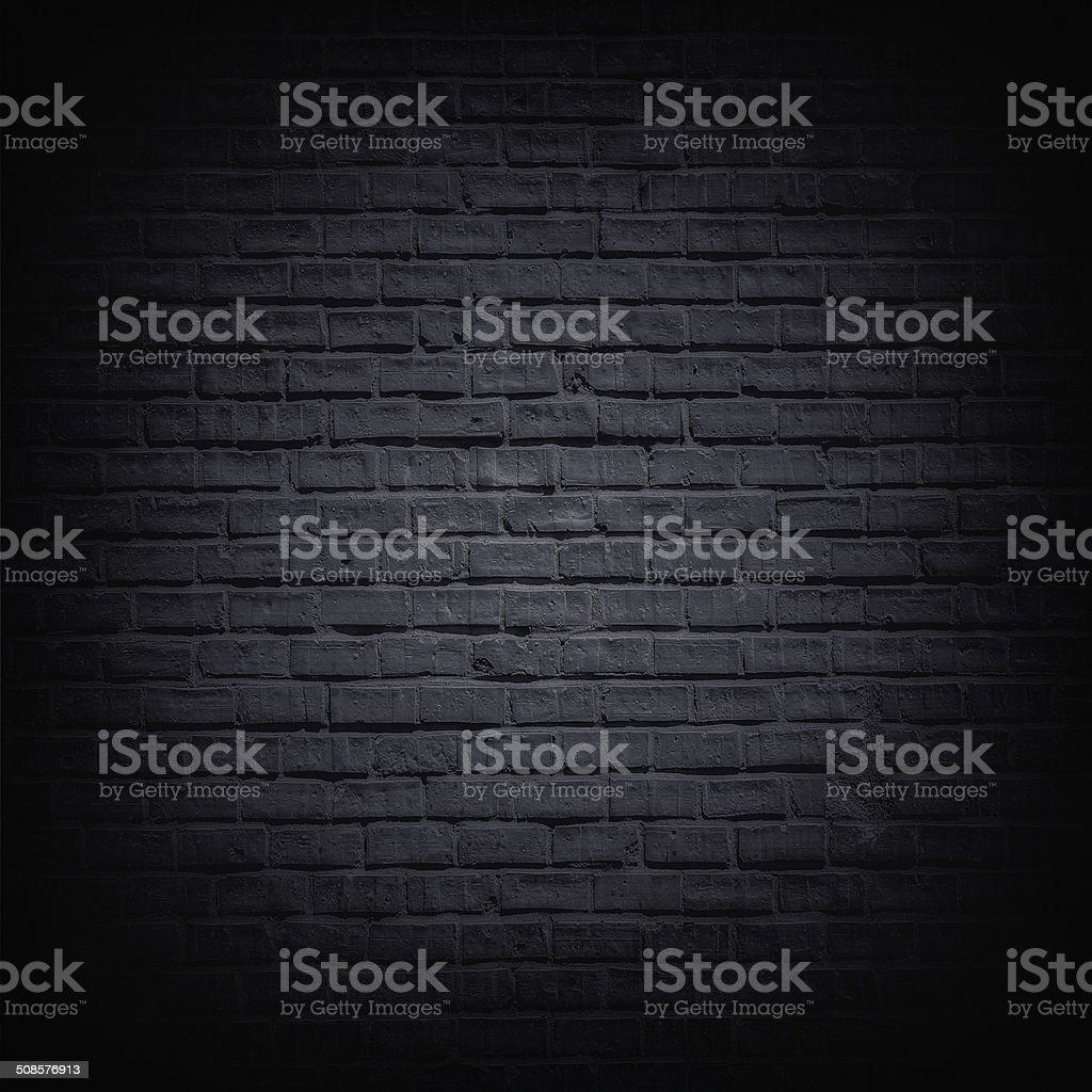 Black brick wall stock photo