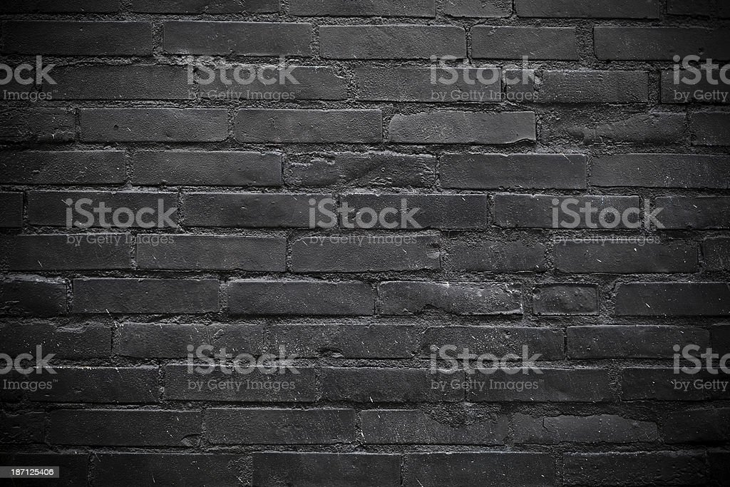 Black brick wall. Vignetting added stock photo