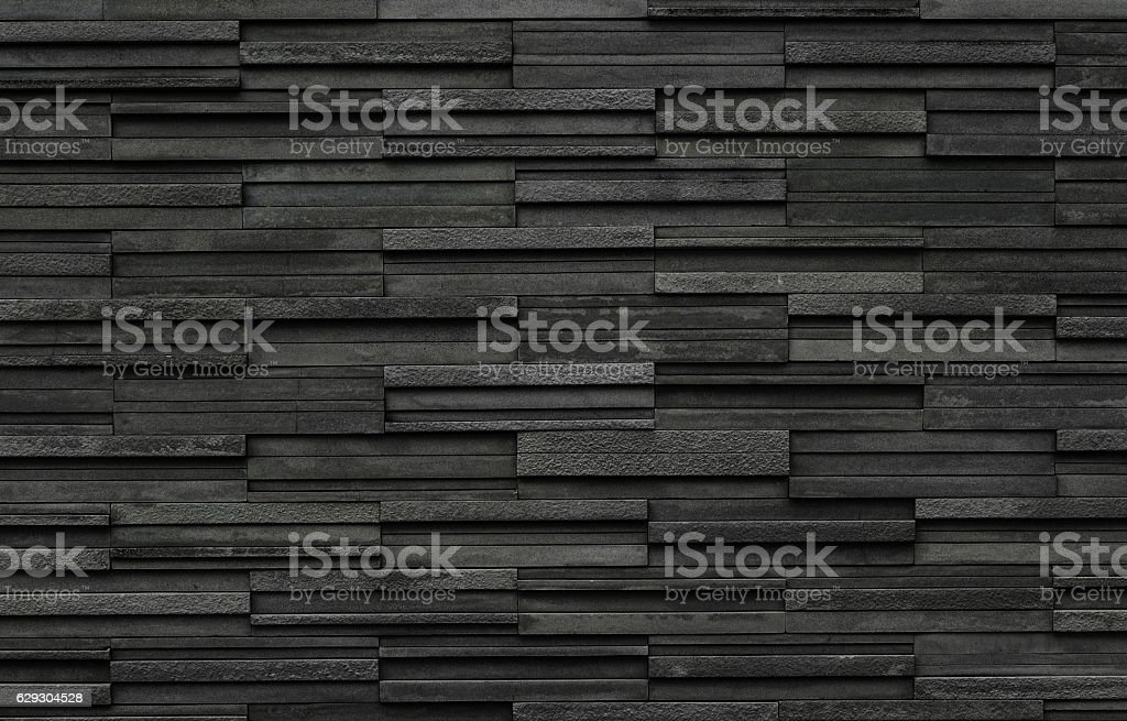 Black bricks slate texture background, slate stone wall texture stock photo