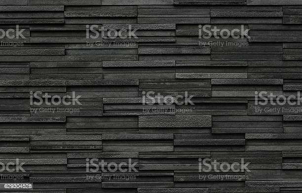 Photo of Black bricks slate texture background, slate stone wall texture