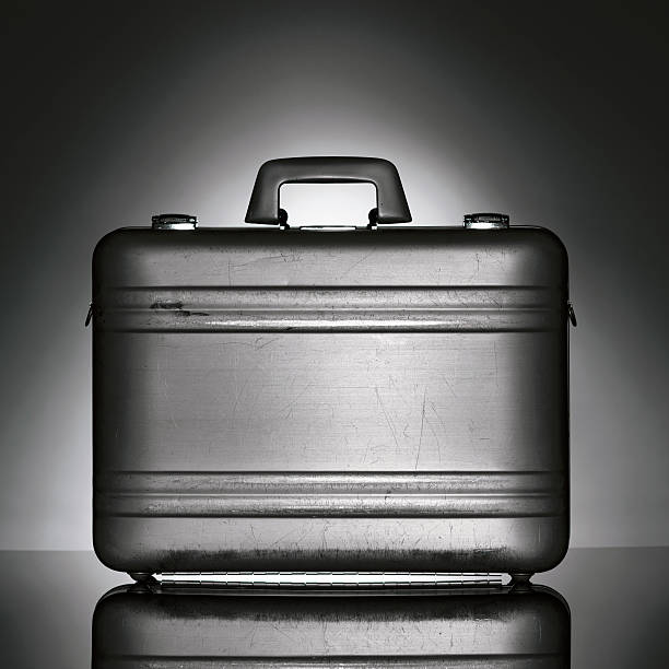 Black brief case isolated on a abstract background stock photo