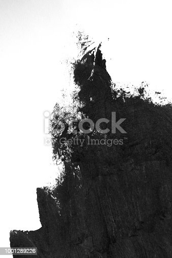 istock Black brush strokes on white paper isolated 1001289226