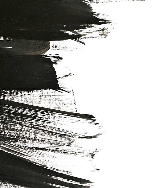 black brush strokes on white paper - foto de acervo
