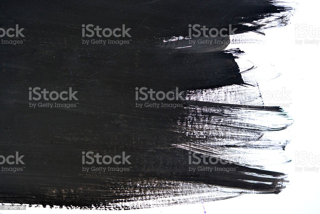 black brush strokes on white paper stock photo