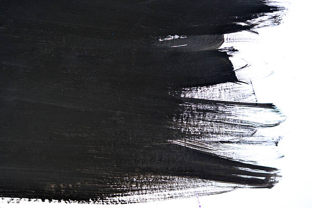 black brush strokes on white paper - foto stock