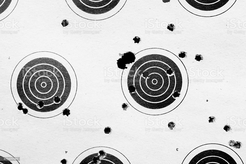 Black Bullet Holes on a White Background stock photo