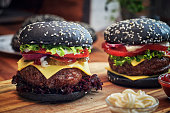 Black Burger Buns with Beef Pattie, Cheese, Tomato and Lettuce