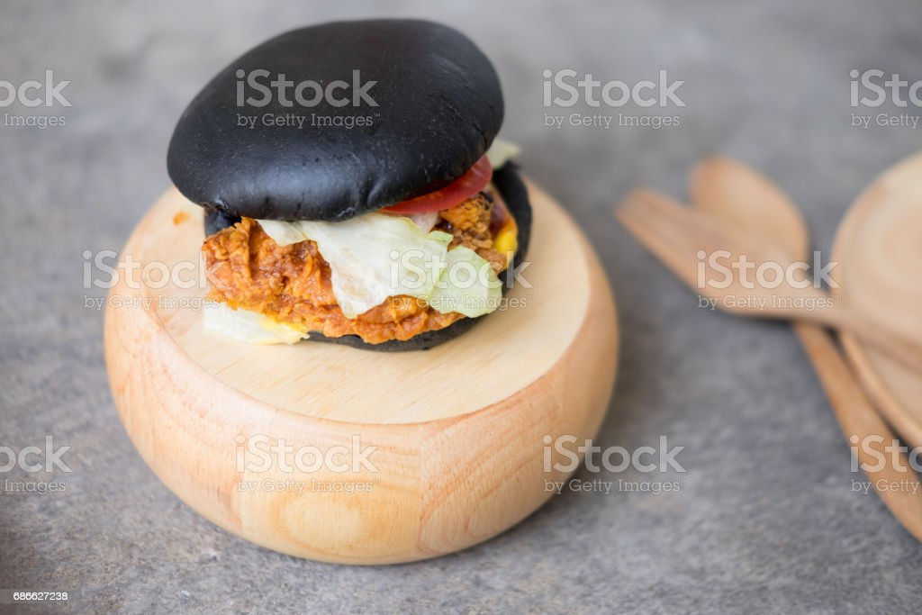 Black burger on wooden background 免版稅 stock photo