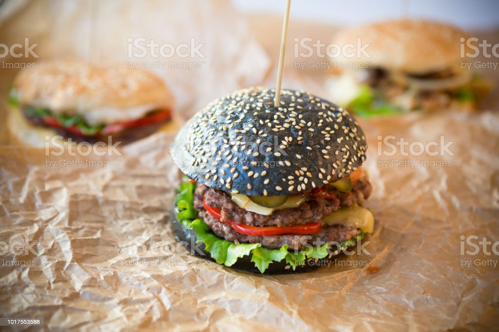 Black burger with thick beef meat stock photo