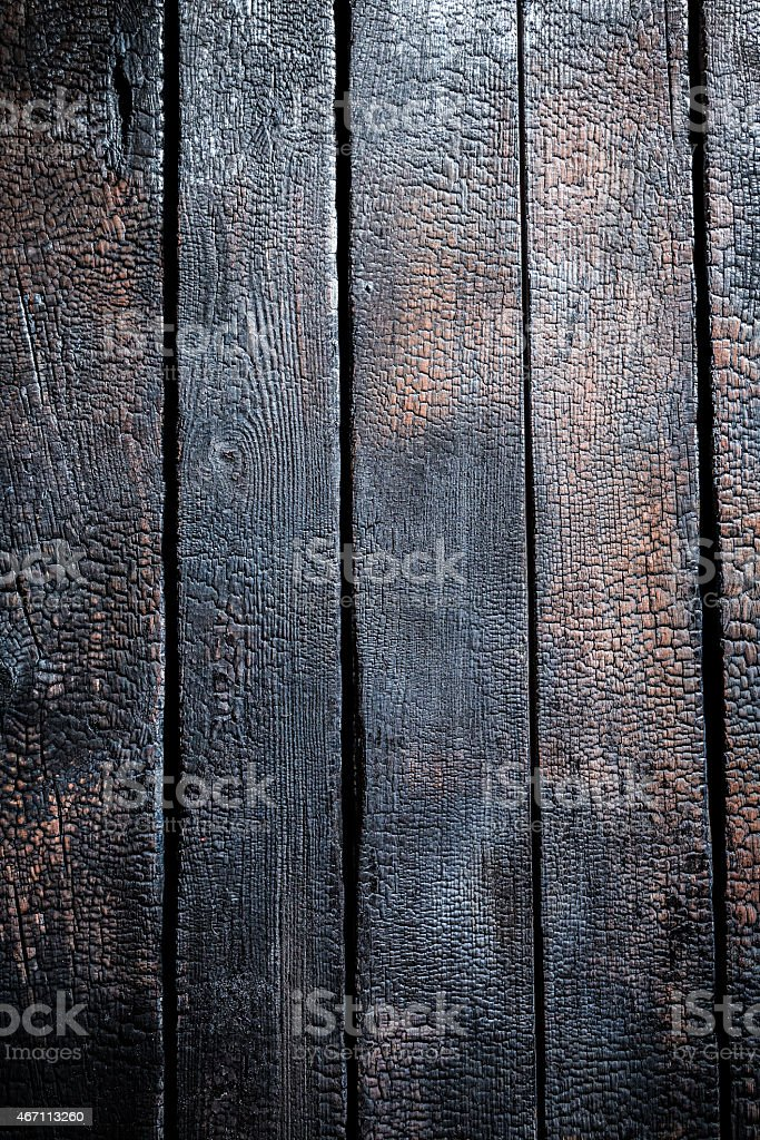 Black burnt wooden background stock photo