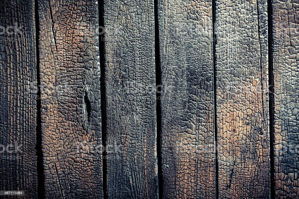 Black burnt wooden fence stock photo
