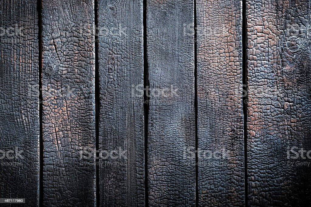 Black burnt wooden table stock photo