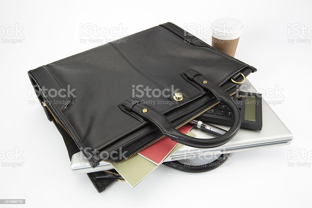 Black business briefcase with laptop and cup of coffee stock photo