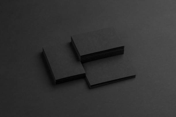 black business cards isolated on black background - nieruchomy zdjęcia i obrazy z banku zdjęć