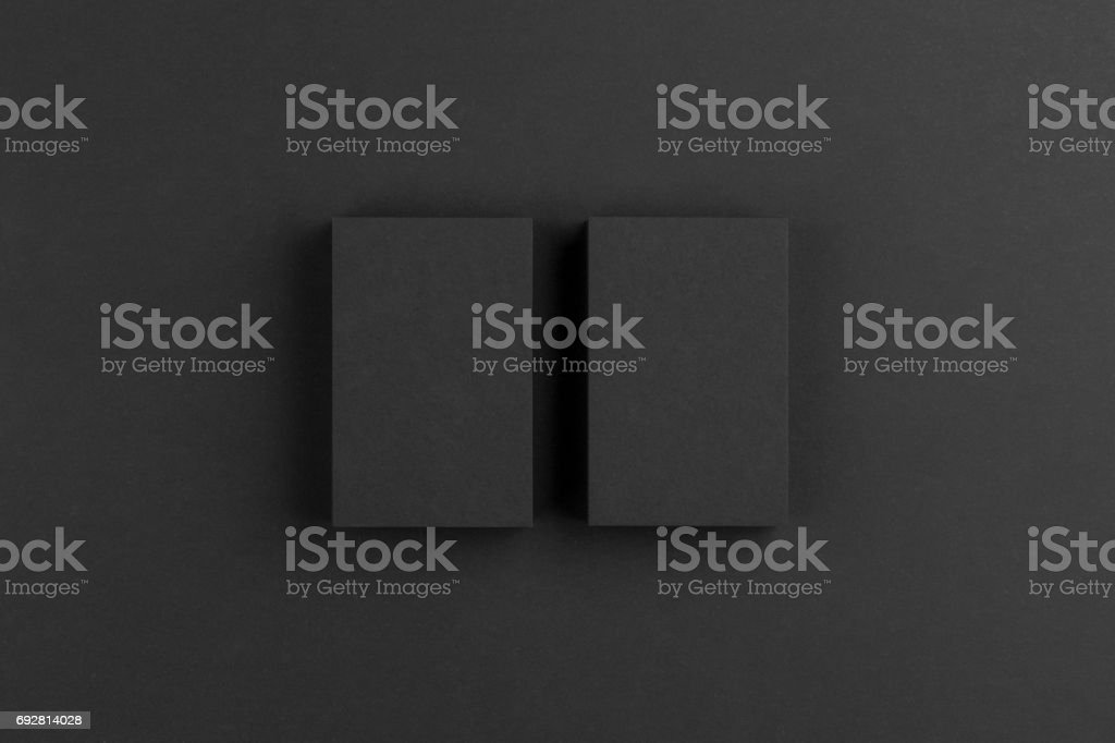 Black business cards isolated on black background stock photo