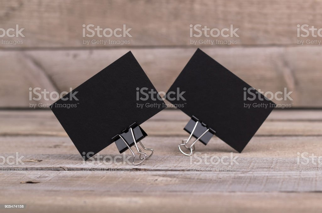Black business cards isolated on old wood background stock photo