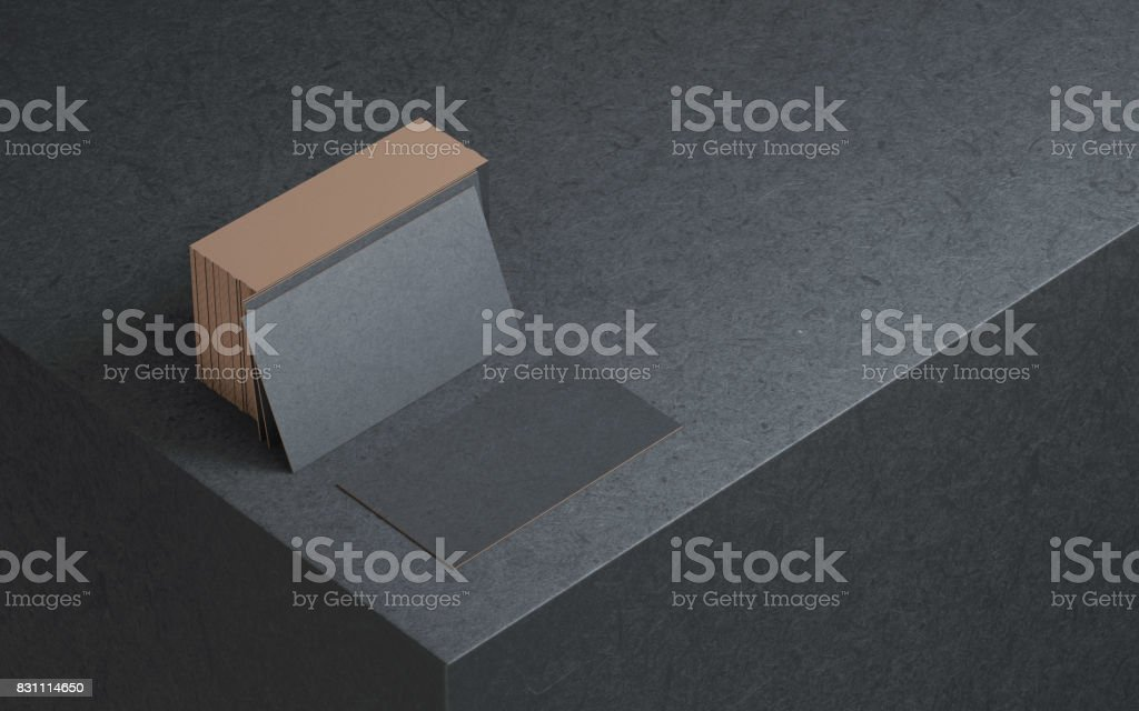 Black business cards mockup with golden foil on the edges, 3d rendering stock photo
