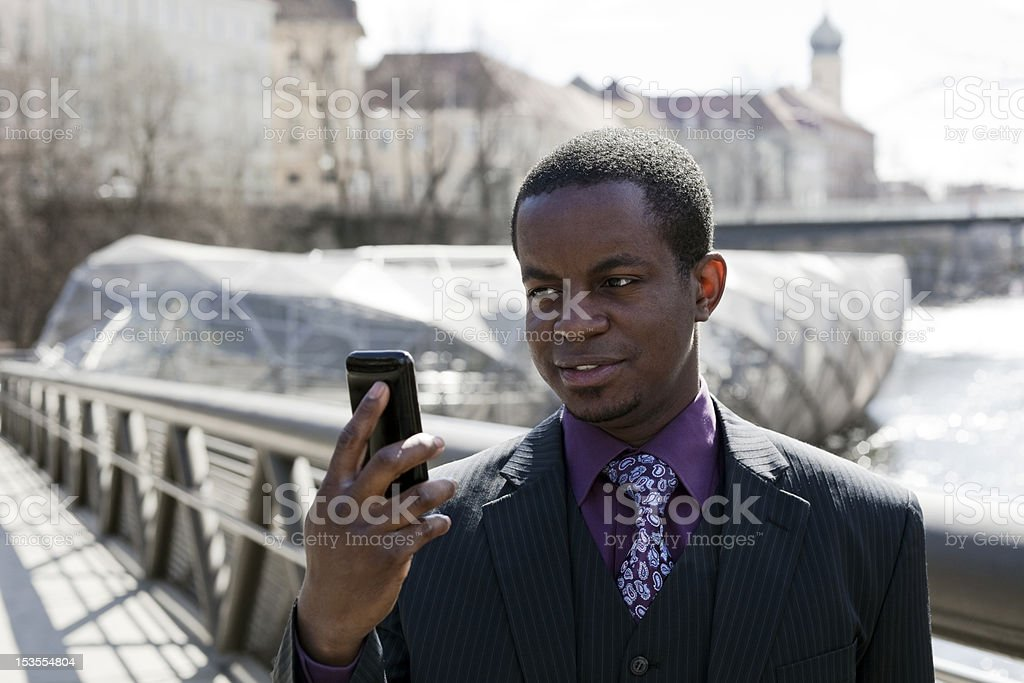 Black business man looking on smart phone royalty-free stock photo