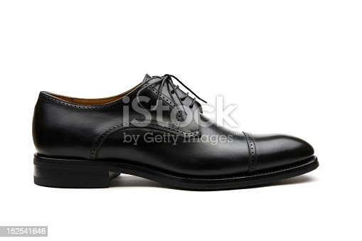 Black leather men's dress shoe on white background