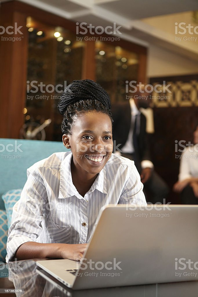 Black Business Woman smiling while she works late stock photo