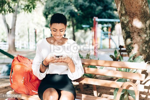 istock Black business woman texting on smartphone 1158720414