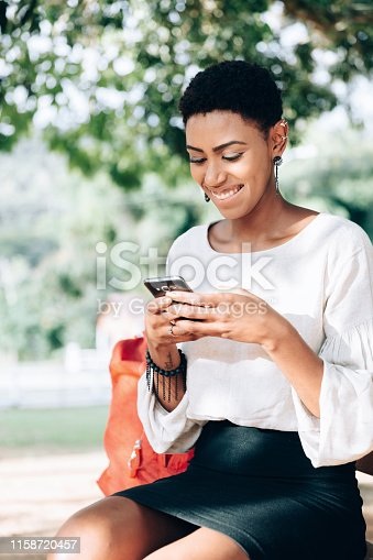 istock Black business woman texting on smartphone 1158720457