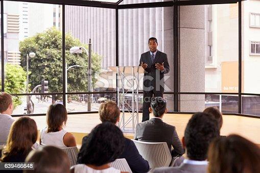 istock Black businessman presenting seminar gesturing to audience 639466648