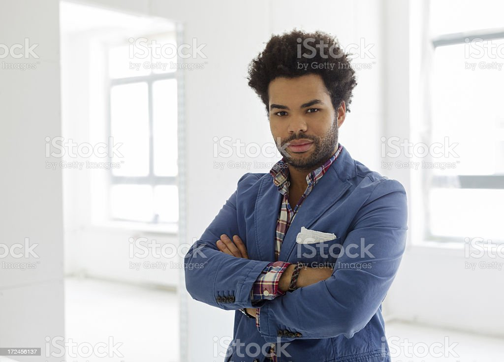 Black businessman standing in new office royalty-free stock photo