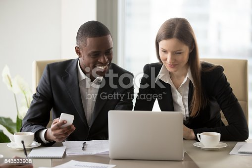 istock Black businessman working with white businesswoman 843533938