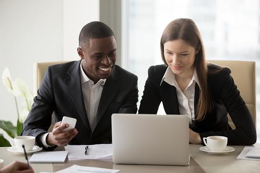 istock Black businessman working with white businesswoman 843533938