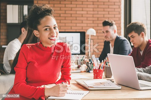 629805626 istock photo Black businesswoman in office with her colleagues 952644208